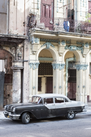 Old Pontiac next to crumbling buildings on June 21, 2013 in Havana Stock Photo - 20449621