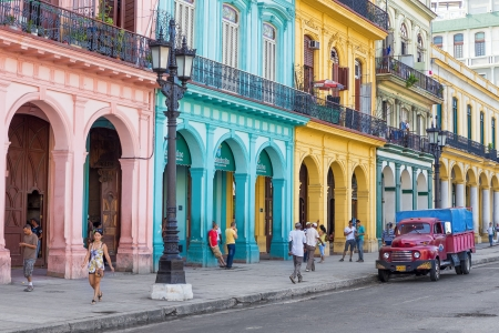 Typical street scene with people and colorful buildings on June 21, 2013 in Havana