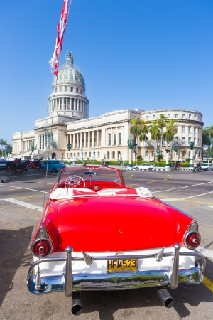 Classic convertible red Ford near the Capitol on June 21, 2013 in Havana These classic cars are a worldwide famous sight and a tourist attraction of the island Stock Photo - 20449620