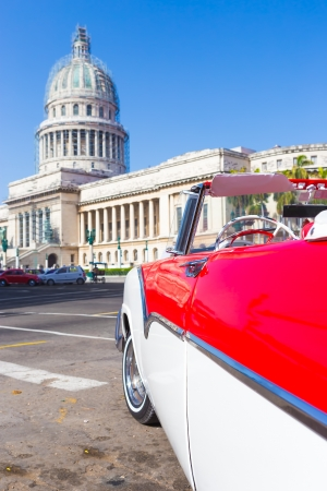Classic convertible red Ford near the Capitol on June 21, 2013 in Havana Stock Photo - 20449611