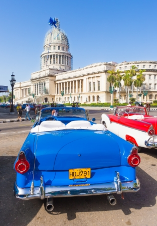 Antique convertible Ford near the Capitol on June 21, 2013 in Havana Stock Photo - 20449613
