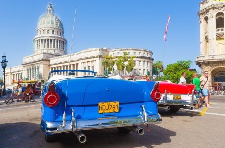 Antique convertible Ford near the Capitol on June 21, 2013 in Havana Stock Photo - 20449618