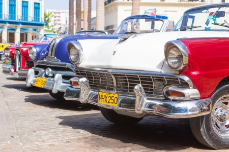 Classic Ford and other vintage american cars on June 21, 2013 in Havana These classic cars are a worldwide famous sight and a tourist attraction of the island Stock Photo - 20449606
