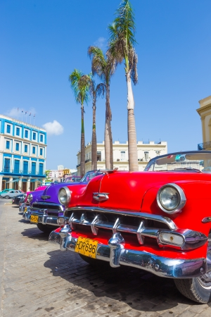 Antique red chevrolet and other vintage american cars on June 21, 2013 in Havana These classic cars are a worldwide famous sight and a tourist attraction of the island