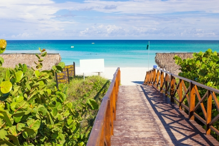 Wooden resort walkway leading to the tropical beach of Varadero in Cuba photo