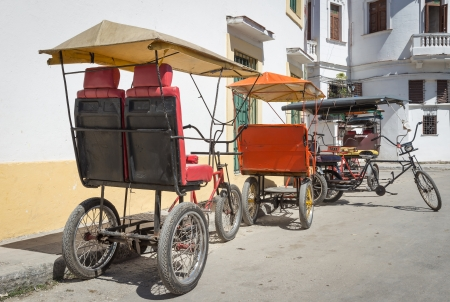 Group of old bicycles used as taxis in Havana Stock Photo - 22991314