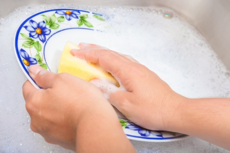 soapy: Hands washing the dishes on soapy water