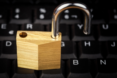 Open padlock on a black computer keyboard useful to illustrate data security Stock Photo