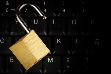 Open padlock on a black computer keyboard with space for text Stock Photo