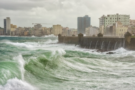 windy city: Tropical cyclone in Havana with huge waves hitting the sea wall Stock Photo