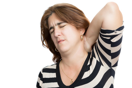 Hispanic woman suffering from neck or cervical pain isolated on white photo