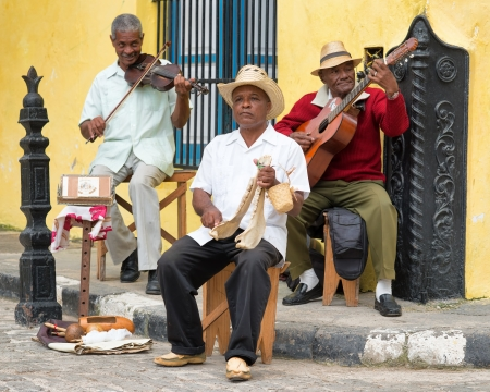 afro caribbean: Afrocuban street musicians playing traditional music in Cuba
