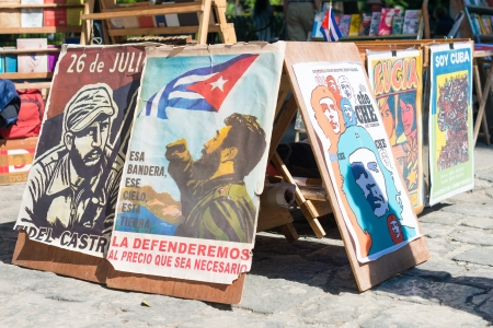 che guevara: Posters with revolutionary slogans for sale at a street market Editorial