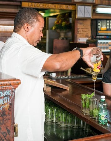 Bartender preparing mojitos at La Bodeguita del Medio This famous restaurant was a major attraction for the almost 3 million tourists who visited Cuba in 2013