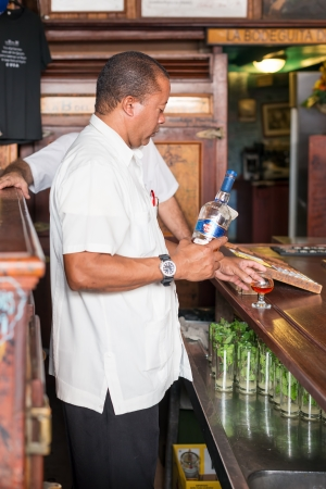 Bartender working at La Bodeguita del Medio This famous restaurant was a major attraction for the almost 3 million tourists who visited Cuba in 2013 Editorial