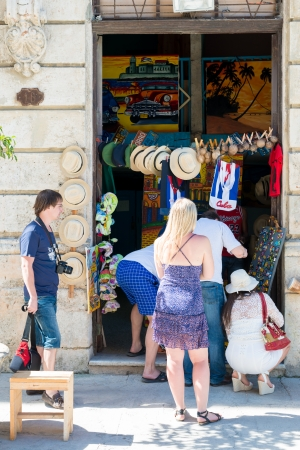 Tourists buying typical souvenirs at a street market The tourism industry received over 2 8 million foreign visitors in 2013