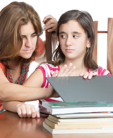 Worried mother checks her daughter internet activity  isolated on white Stock Photo - 25667679