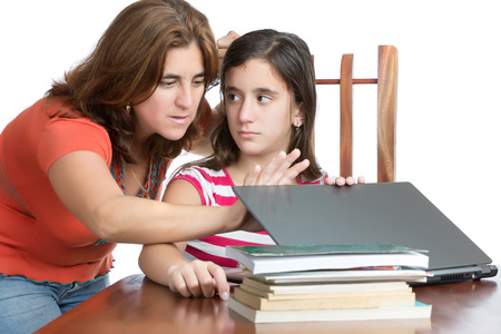 Worried mother checks her daughter internet activity  isolated on white  photo