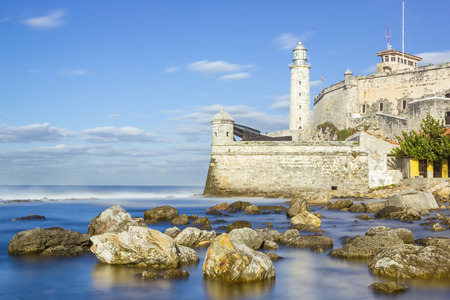 Long exposure image of the fortress of El Morro in the bay of Havana with rocks and silky water photo