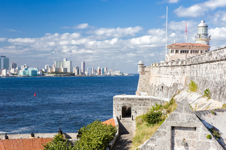The fortress and lighthouse of El Morro with the Havana skyline photo