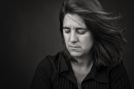 latina female: Dramatic black and white portrait of a very sad and lonely hispanic woman