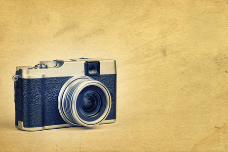 rangefinder: Vintage rangefinder style camera on a textured background  with space for text Stock Photo