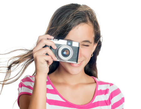 viewfinder vintage: Beautiful young girl taking a picture with a vintage looking  compact camera looking through the viewfinder  isolated on white  Stock Photo
