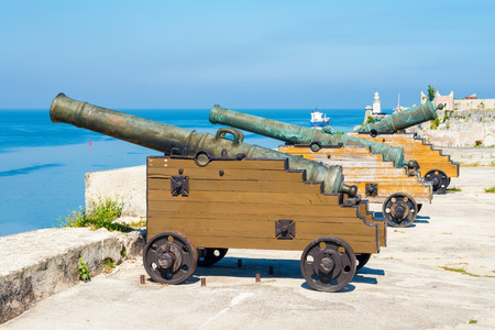 Old spanish cannons in the fortress facing the city of Havana in Cuba photo