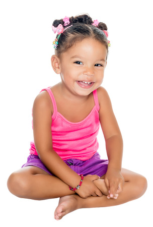Multiracial small girl laughing sitting on the floor  isolated on white  Stock Photo