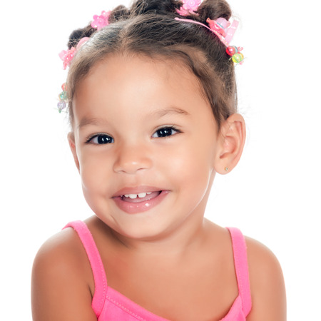 Close-up of a  multiracial small girl smiling isolated on a white background photo