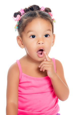 Multiracial small girl with a funny inquisitive expression  isolated on white