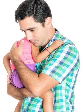 Tired and worried hispanic father carrying his small daughter isolated on white photo