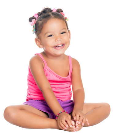 Multiracial small girl laughing sitting on the floor  isolated on white  photo