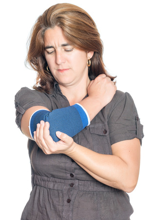 Woman with an injured painful arm elbow wearing a therapeutic elastic support band isolated on white photo