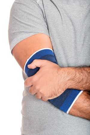 elbow pad: Injured, pain - Man with a therapeutic elastic band on his elbow isolated on white Stock Photo