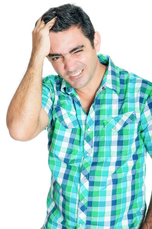 Man suffering a strong headache isolated on white Stock Photo - 27465114