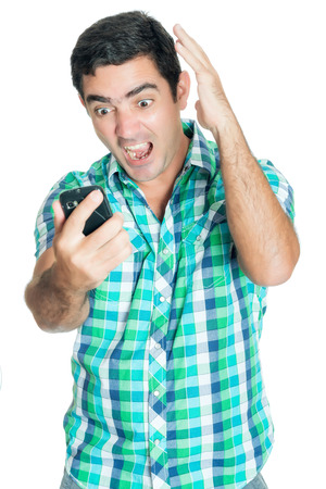 agitated: Agitated man yelling at his mobile phone and gesturing with his hands (isolated on white)