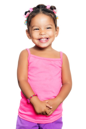 Cute multiracial small girl with a funny expression isolated on a white background Stock Photo