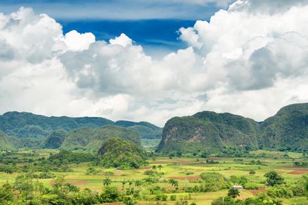 Scenic view of the Vinales Valley in Cuba with a beautiful puffy clouds sky photo