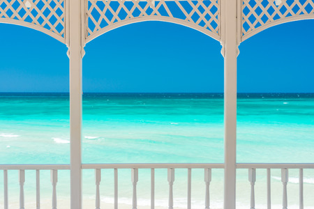Romantic wooden terrace with a view of a tropical beach in Cuba photo