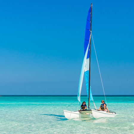 Girls sailing on a colorful catamaran at Varadero beach in Cuba photo
