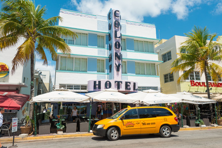 MIAMI,USA - MAY 21,2014 : The Colony Hotel at Ocean Drive in Miami Beach, Florida. This famous Art Deco building in South Beach is one of the photographed attractions in Florida Stock Photo - 28690556