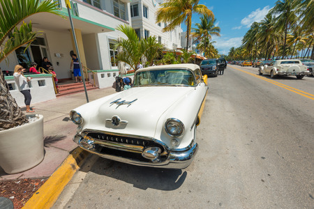 MIAMI,USA - MAY 21,2014   Vintage car parked at Ocean Drive in Miami Beach, Florida  Art Deco architecture in South Beach is one of the main tourist attractions in Miami