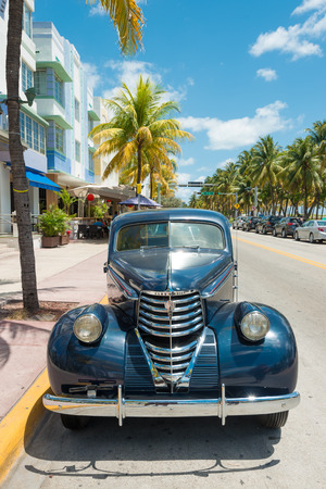 MIAMI,USA - MAY 21,2014 : Vintage car parked at Ocean Drive in Miami Beach, Florida. Art Deco architecture in South Beach is one of the main tourist attractions in Miami Stock Photo - 28690595