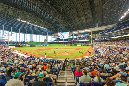 baseball crowd:  The Miami Marlins play the Atlanta Braves in a game of the Eastern Division of Major League Baseball National League