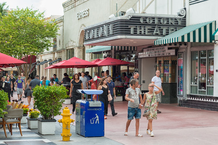 Tourists walking by the famous Colony Theatre at the  Lincoln Road Boulevard in Miami Beach