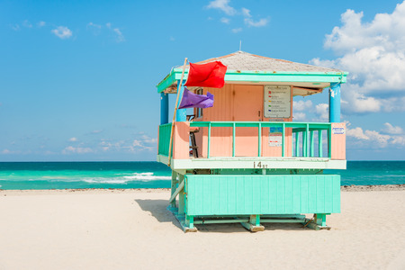 Lifeguard tower in South Beach, Miami on a beautiful summer day photo