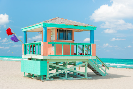 Colorful lifeguard tower in Miami Beach on a beautiful summer day photo
