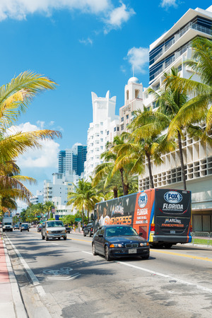 MIAMI,USA - MAY 20,2014   Famous art deco hotels and traffic  at Collins Avenue on a sunny day at Miami Beach