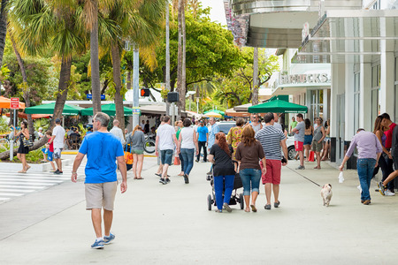 Shoppers and tourists on a sunny day at Lincoln Road, a famous dining and shopping boulevard at Miami Beach